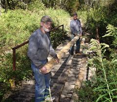 Bridge repair: Ray Dart (front) and Corky Hull (rear)
